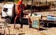 В Астрахани начали убирать опасные бетонные стены